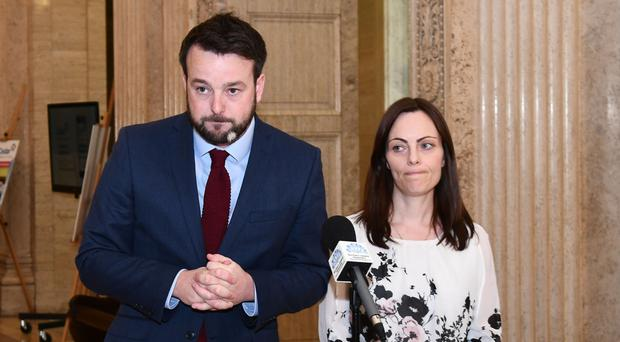 SDLP leader Colum Eastwood and deputy leader Nichola Mallon speak to the media in the Great Hall at Parliament Buildings yesterday