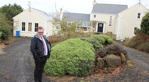 Dr Andrew Biggart outside his home at Glebe Road, Castlerock