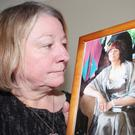 Pamela Henry with a picture of Marion
