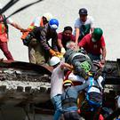 A man is pulled alive from the rubble after a quake in Mexico City