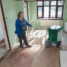 Jacqueline McCready inside home devastated by floods
