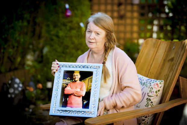 Patricia holding Stephen's picture