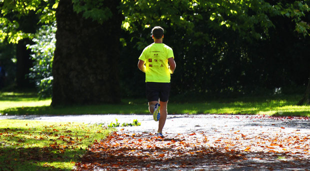 A jogger in Ormeau Park as autumn colours start to appear on the trees