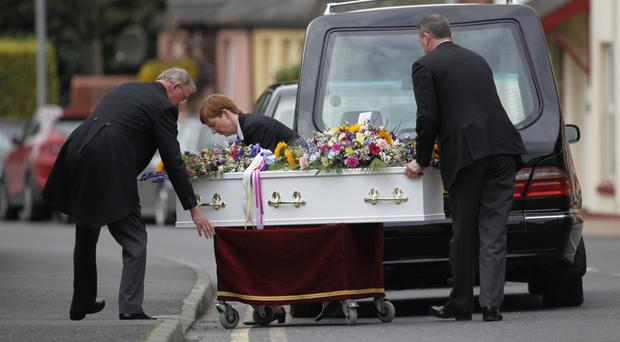 The white coffin of 10-year-old Isobel Anderson is taken into Dromore Cathedral yesterday