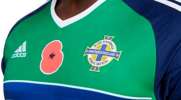 International football chiefs are to lift the controversial ban on wearing the commemorative poppy by the home nations