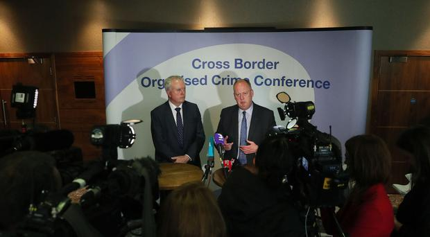 Acting Garda Commissioner Donal O Culain (left) and PSNI Chief Constable George Hamilton speaking to the media.