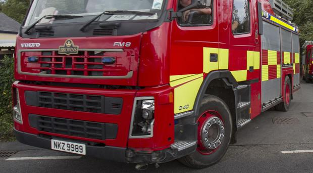 A woman in her 50s has died as a result of a house fire in Holywood.