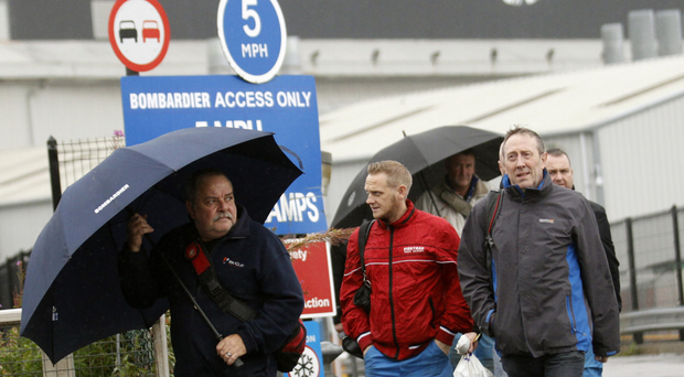 Bombardier workers leave the aerospace factory in Belfast yesterday