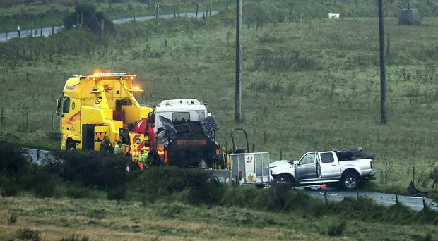 Emergency services at the scene of the tragic road crash in Hannahstown