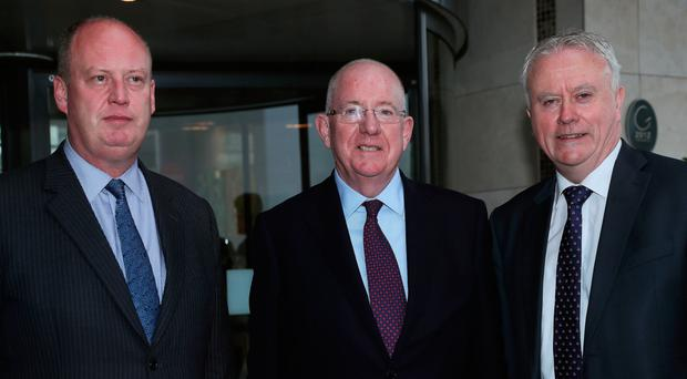 PSNI Chief Constable George Hamilton, the Republic's Justice Minister Charlie Flanagan and Acting Garda Commissioner Donal O Culain yesterday