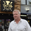 Ribs and Bibs owner Malachy Turner at his Botanic Avenue restauraunt
