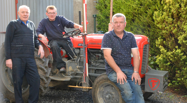 Ploughmen William Gamble (left) and his son Nigel (right) have now been joined by young Marc (centre).