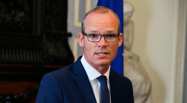 Upbeat: Simon Coveney