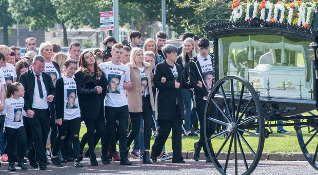 The family of Jordan McConomy lead the cortege on the way to St Joseph's Church in Galliagh