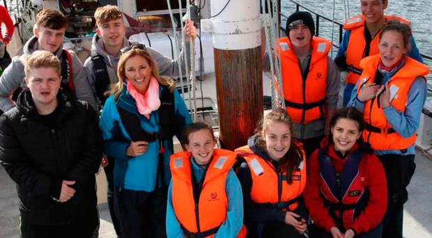 BBC One Songs of Praise presenter Claire McCollum with the young cross border crew on the Brian Boru