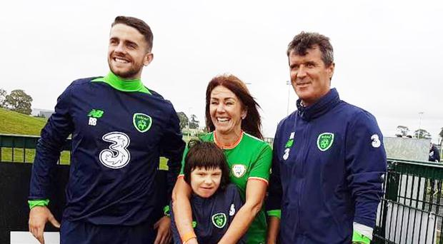Billy Caldwell and mum Charlotte with Republic of Ireland player Robbie Brady (left) and assistant manager Roy Keane