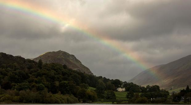 A rainbow over Grasmere in the Lake District, as more strong winds and rain sweep across northern parts of the UK