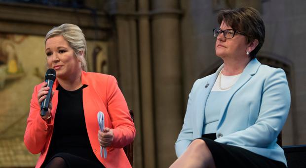DUP leader Arlene Foster and Sinn Fein's Michelle O'Neill attend the Ulster fry breakfast at Manchester Town Hall yesterday. PA