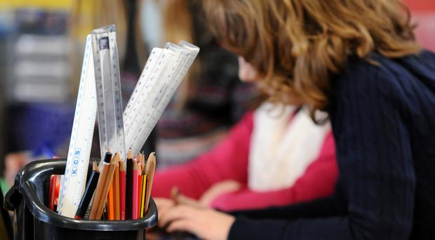 Robots could be used to teach maths and reading to primary school pupils, headteachers were told
