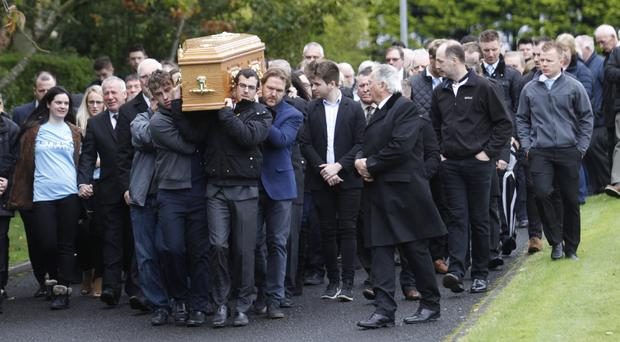 Mourners carry the coffin of Stephen Wilkinson from the Church of the Blessed Sacrament in Mullinahoe
