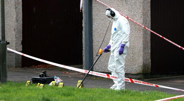 A forensic officer at the scene of the shooting in Craigavon