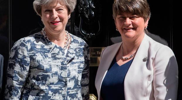 DUP leader Arlene Foster with Prime Minister Theresa May outside 10 Downing Street in June