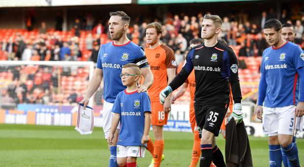 Linfield captain Jamie Mulgrew leads out his side against Dundee United