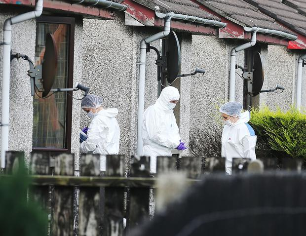 Police at the scene of the death in Larne yesterday