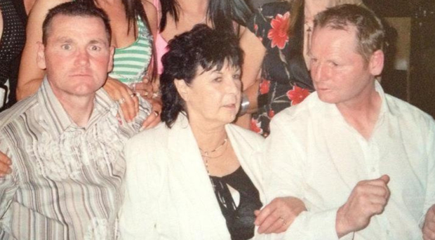Murder victim Laurence Shaw (right) with brother John and mother Margaret