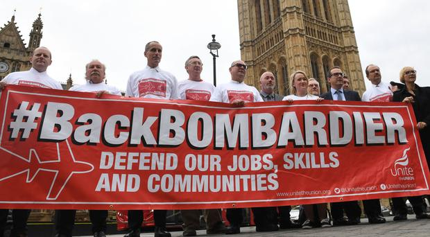 Labour MP Owen Smith (wearing glasses, third right) with workers from plane manufacturer Bombardier lobbying the Houses of Parliament in central London.
