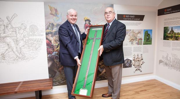 Co Armagh Grand Master Denis Watson (right) and county secretary Roger Gardiner with Sarsfield's sword which has gone on public display at the Museum of Orange Heritage, Loughgall