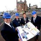 In Portrush, where work is set to begin on a multi-million pound public realm scheme, are (from left) Robert Preston of AECOM, Enda Shields from contractor FP McCann, the Mayor of Causeway Coast and Glens Borough Council, Joan Baird OBE, and Ian McQuitty, Department for Communities Development Officer