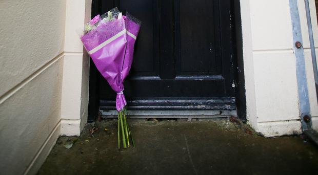 Flowers left at the apartment in west Belfast yesterday