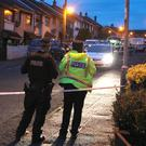 Police at the house in Newtownabbey where the boy lived
