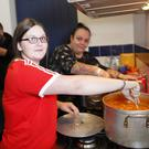 Volunteers Kaye Tourish and daughter Kathleen serving food for the homeless people during the soup kitchen at St Patrick's