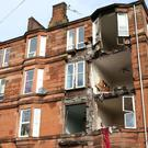 The scene in Crosshill, Glasgow, after the front of a block of flats was brought down in high winds as Storm Ophelia sweeps across Scotland