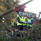 Taoiseach Leo Varadkar meets workers clearing fallen power lines in Kilcock, Co Kildare