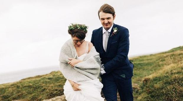 Newlyweds Amber and Thomas Hamilton brave the cliffs at Ramore Head in Portrush