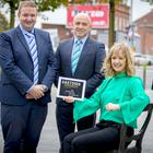 Tara Mills with Jonathan McAlpin of East Belfast Enterprise and Stephen Patton of George Best Belfast City Airport