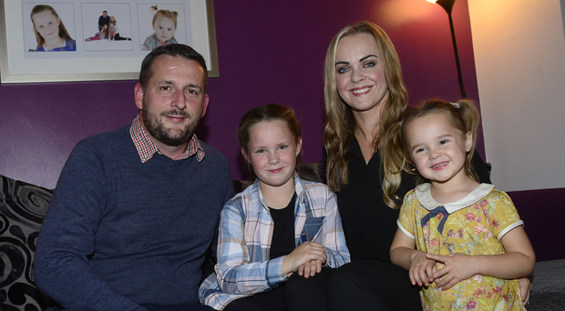 The O'Donnell family, Aoibhe (7) and Meabh (3), dad Gerald and mum Maire-Iosa McVicker, at home in Downpatrick