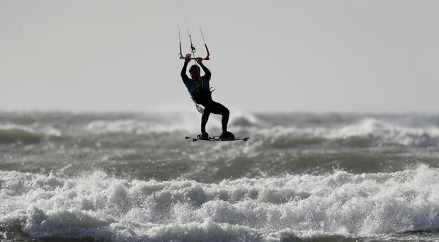 A kitesurfer off West Wittering beach in West Sussex, as the UK prepares for heavy wind and rain this weekend