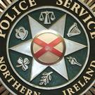 Police investigate a chain of cars set on fire in Belfast on Sunday morning.
