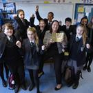 Malone College pupils help Principal Marie Thompson celebrate her award