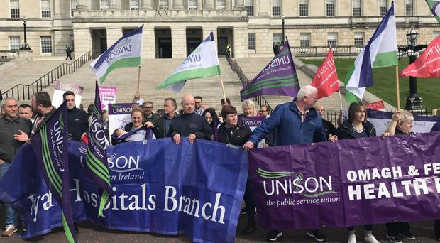 Last month protests were held outside Parliament Buildings against budget cuts to health trusts