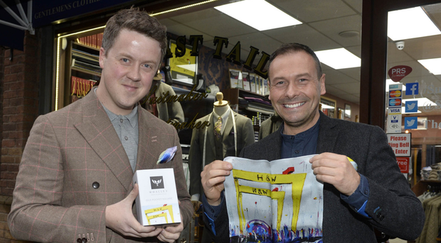 Chris Suitor with artist Stephen Whalley (right) at Suitors menswear in Belfast