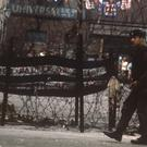 Troops on duty beside barbed wire barriers in the Falls Road area of Belfast during the Troubles