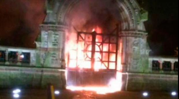 The gates of Milltown Cemetery on fire