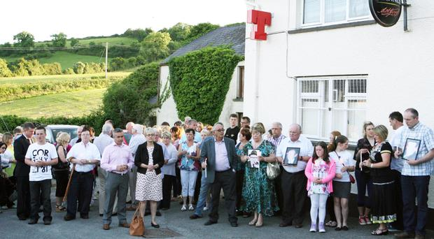 Mourners attend the 20th anniversary of the Loughinisland massacre in 2014