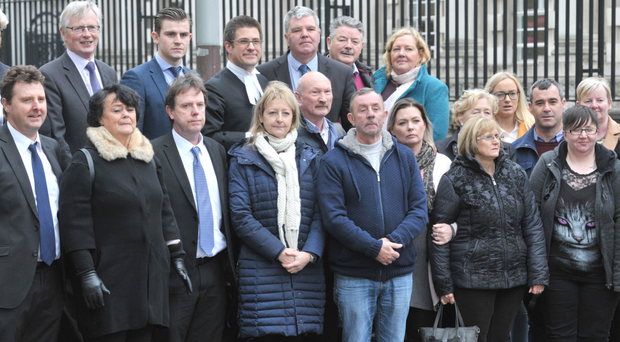Families of some of the victims of the so-called Glenanne Gang outside Belfast High Court yesterday