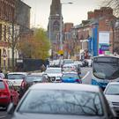 Cars parked in the bus lane on the Antrim Road (Belfast Bound) between Cavehill Road and Cliftonville Road